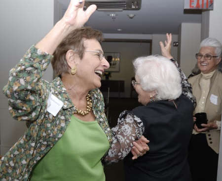 Women dancing & laughing - Photo by Mimi Katz
